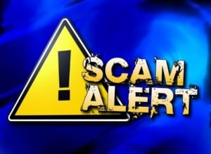 """""""Sacm Alert"""" With Caution sign in background   SCAM related to the CARES Act Stimulus Payments   Dalby Wenldand & Co"""