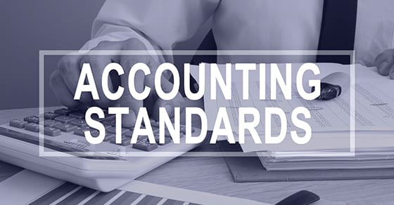 man working on financials and words accounting standards | why cpa designation matters | Dalby Wendland & Co. | CPAs | Business Advisors | Grand Junction CO | Glenwood Springs CO | Montrose CO