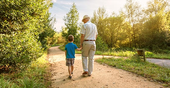 grandfather walking on path with young grandson | about dynasty trusts | estate planning | Dalby Wendland & Co | CPAs | Estate Trust and Gift Tax Planning | Colorado