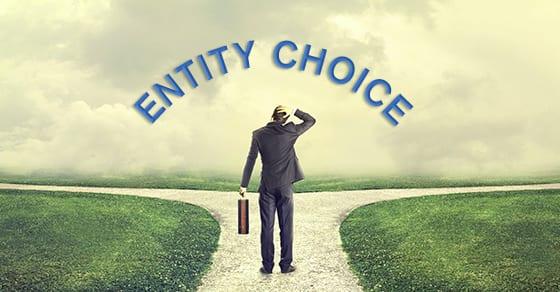 business man standing in front of the words business entity | best entity choice for your business | Dalby Wendland & Co. | CPAs | Business Advisors | Grand Junction CO | Glenwood Springs Co | Montrose CO