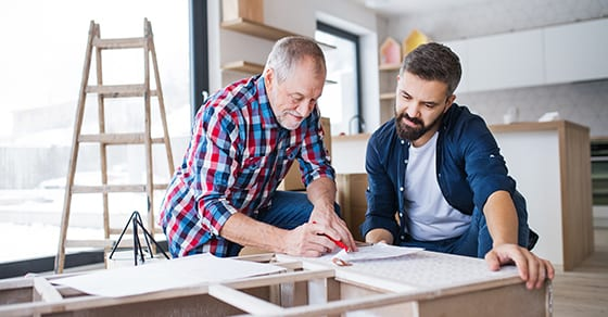 father and adult son looking at home building plans | Unintentional Consequences of Jointly Owning Property with Family Members | Dalby Wendland & Co | CPAs | Business Advisors | Estate Tax Planning | Colorado