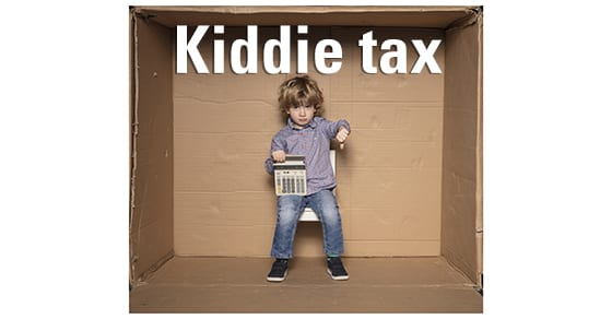 "small boy holding investment calculator | TCJA Makes ""Kiddie Tax"" Worse 