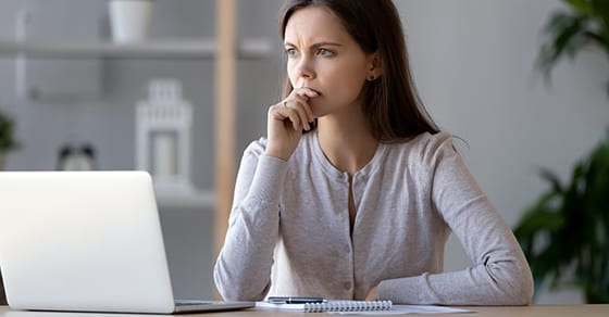 woman at desk contemplating a decision | namingyour trustee | Dalby Wendland & Co. | CPAs | Business Advisors | Estate Trust & Gift Tax Planning | Colorado