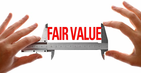 "hands holding a caliper, measuring the words ""fair value"" 