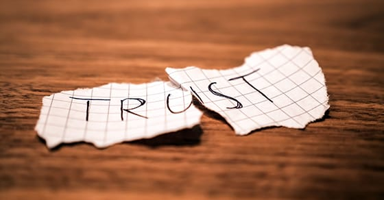 """torn piece of paper with word Trust on it 