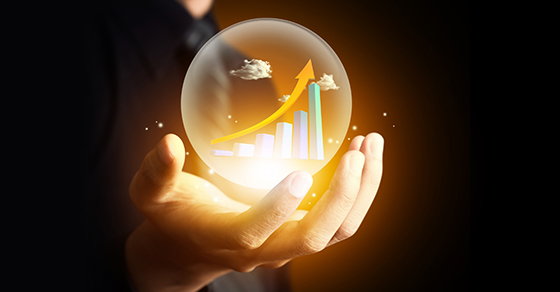 Business hand holding  a crystal ball with arrow pointing upward