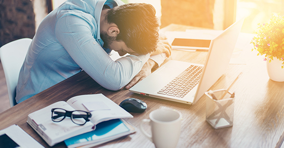 frustrated man at work laying head down on desk | Account for indirect job costs the right way | Dalby Wendland & Co | CPAs & Advisors | Grand Junction CO | Glenwood Springs CO | Montrose CO