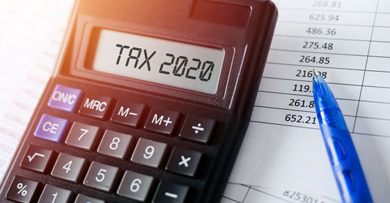 calculator with words tax 2020 on the display | Using an S Corporation May Cut Your Tax Bill | Dalby Wendland & Co. | CPAs & Business Advisors | Grand Junction CO | Glenwood Springs CO | Montrose CO
