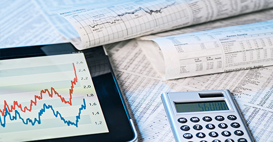 charts showing investments and a calculator   Taxes and Selling Mutual Fund Shares   Dalby Wendland & Co.   CPAs & Business Advisors   Grand Junction CO   Glenwood Springs CO   Montrose CO