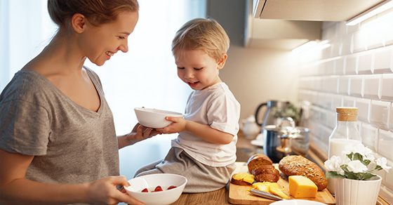 mother and son cooking together in the kitchen | Child Tax Credit More Valuable Under TCJA