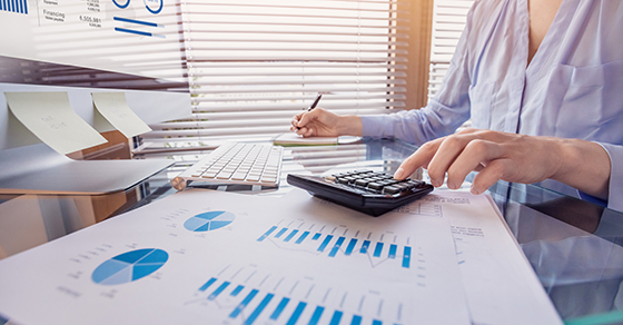 business woman analyzing financial satements | Financial Statements Can Help During COVID-19 | Dalby Wendland & Co. | CPAs & Business Advisors | Grand Junction CO | Glenwood Springs CO | Montrsoe CO