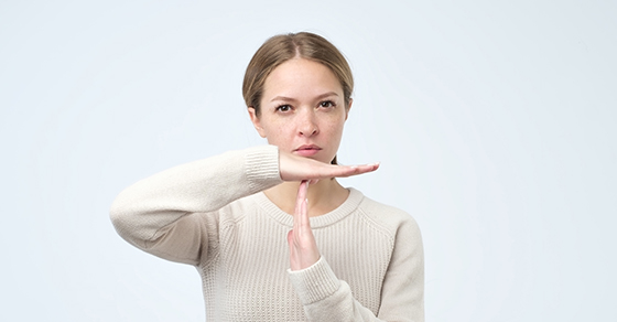 business woman making time-out sign with her hands |  FASB Gives More Time for Updated Revenue Recognition and Leases | Dalby, Wendland & Co. | CPAs & Busines Advisors | Grand Junction CO | Glenwood Springs CO | Montrose CO