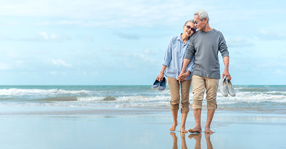 retired couple walking on the beach | Spousal Lifetime Access Trust Can Provide Financial Backup Plan | Dalby Wendland & Co. | CPAs & Business Advisors | Grand Junction CO | Glenwood Springs CO | Montrose CO