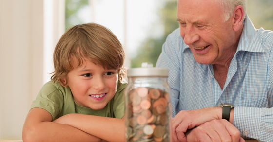 grandfather with grandson saving coins in a jar | Protect Assets Against Creditors With a Trust | Dalby Wendland & Co. | CPAs & Business Advisors | Grand Junction CO | Glenwood Springs CO | Montrose CO