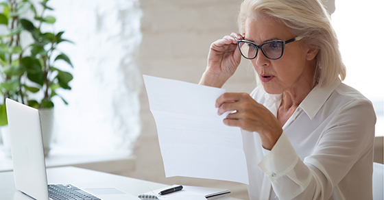 woman surprised by her tax bill   Adjust Your Tax Withholding   Dalby Wendland & Co.   CPAs & Business Advisors