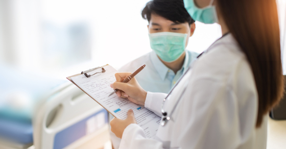 doctors in a hospital looking at paperwork   Your Estate Plan Needs a Health Care Power of Attorney   Dalby Wendland & Co.   CPAs & Business Advisors   Grand Junction CO   Glenwood Springs CO   Montrose CO