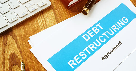 Debt restructuring Agreement with keyboard and pen |  Should a distressed company consider debt restructuring? | Dalby Wendland & Co | CPAs & Business Advisors | Grand Junction CO | Glenwood Springs CO | Montrose CO