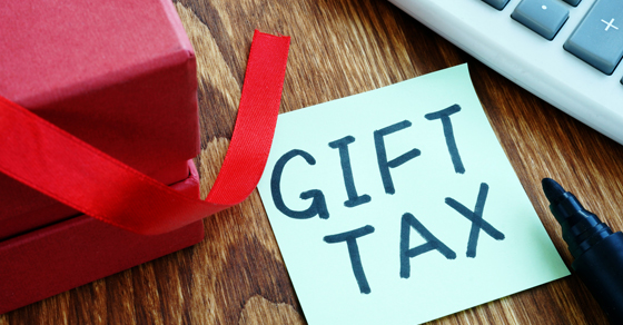 tabletop with a gift box and note with words Gift Tax | When to File a Gift Tax Return | Dalby Wendland & Co. | CPAs & Business Advisors | Grand Junction CO | Glenwood Springs CO | Montrose CO