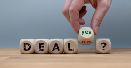 wood blocks with letters spelling deal and words yes or no | tax implications of buying or selling a business | Dalby Wendland & Co. | CPAs & Business Advisors | Grand Junction CO | Glenwood Springs CO | Montrose CO