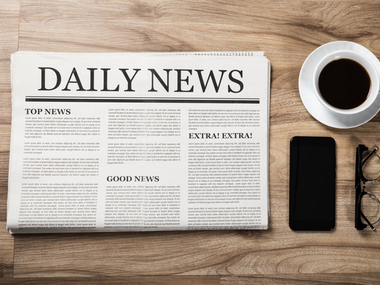 Newspaper with the headline News and glasses and coffee cup on wooden table, Daily Newspaper mock-up concept | IRS Provides Additional Guidance on Food Deduction | Dalby Wendland & Co. | CPAs & Business Advisors | Grand Junction CO | Glenwood Springs CO | Montrose CO
