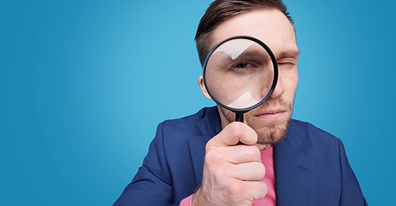 man looking through magnifying glass   internal controls   Dalby Wendland & Co.   CPAs & Business Advisors   Grand Junction CO   Glenwood Springs CO   Montrose CO
