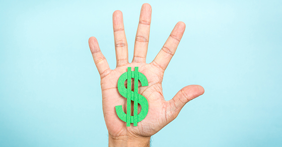 open palm of a hand with a green dollar sign | accounts receivable | Dalby Wendland & Co. | CPAs & Business Advisors | Grand Junction CO | Glenwood Springs CO | Montrose CO