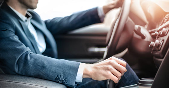 business person driving in company car